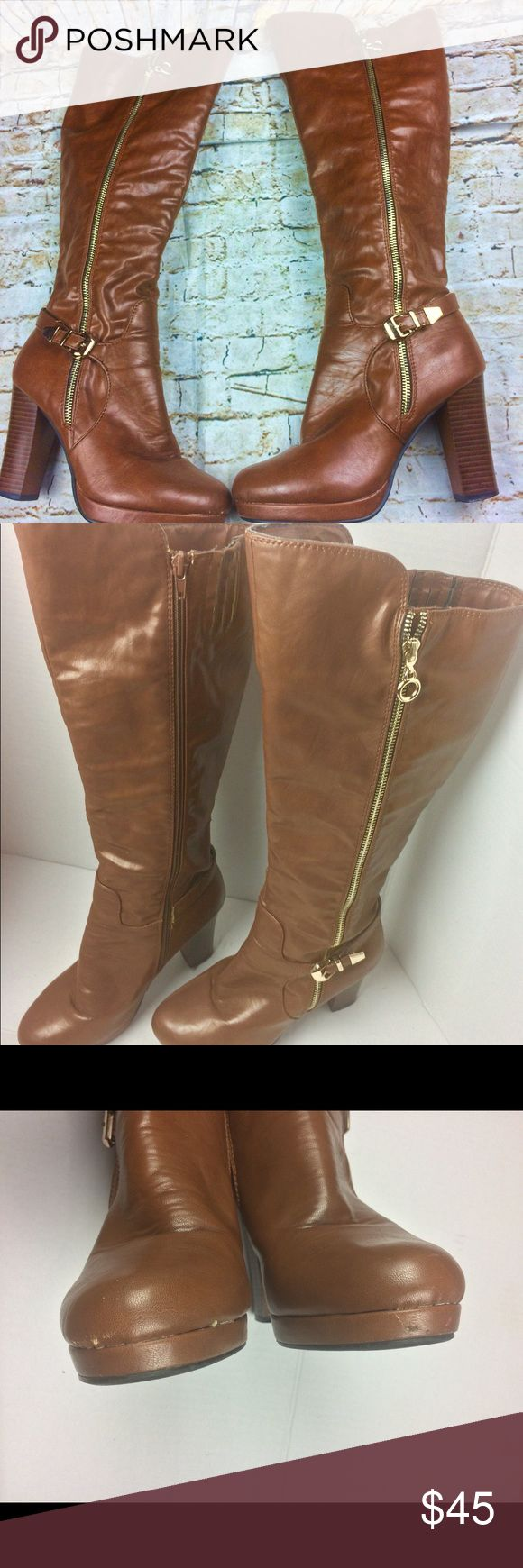 Henry Ferrera New York Knee High Boot Lopez Size 7 Henry Ferrera New York knee high heel boots . Lopez 400 style cognac color . Woman's Size 7 zips up on one side with a gold colored zipper and Buckle on the other side . There is some peeling on the front sole a small spot on the back and top interior as pictured .The material is Synthetic PU . The heels are 4 inches high Henry Ferrera New York Shoes Heeled Boots