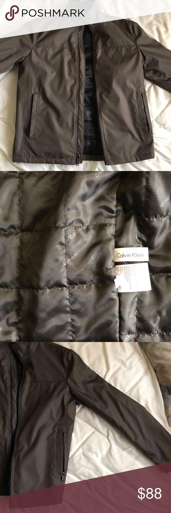 Calvin Klein brown zip up jacket Calvin Klein brown zip up jacket, black inside, zip up pockets on outside, coat pockets on inside Calvin Klein Jackets & Coats Lightweight & Shirt Jackets
