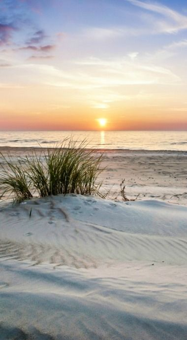 Sand dunes and ripples in the sand by the sea oats, sea grass. Just welcomes you to walk on the beach at sunset!