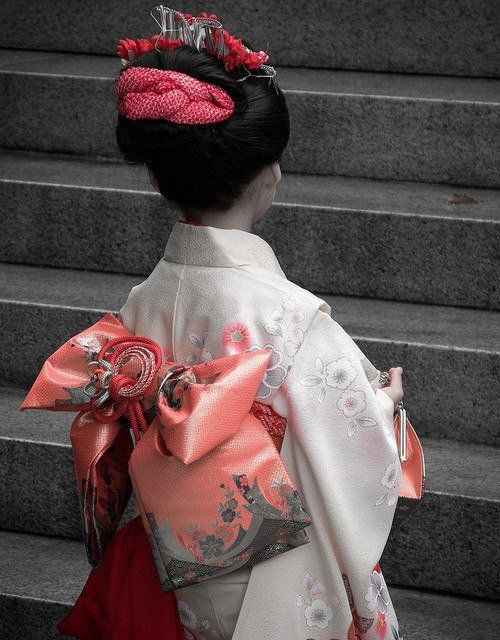 A young girl in furisode with a complex obi knot.
