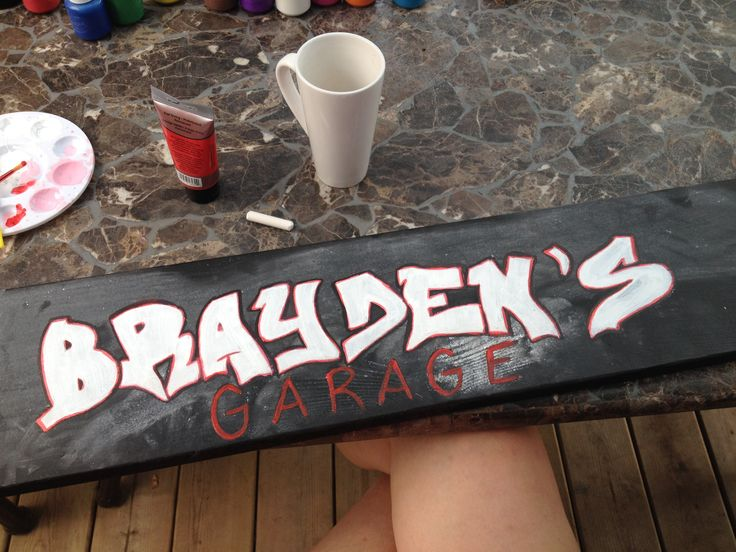Sign for Brayden's garage for his cadillac.