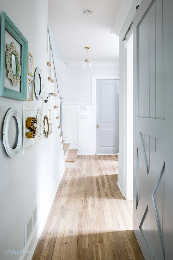 hallway with sliding barn door and gallery wall