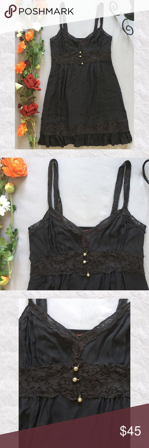 """Betsey Johnson Lace A-Line Mini Dress *SALE IS FOR DRESS ONLY! *Bought this for myself but ended up being a little too sexy for me. Has a nighty overall feeling to it. Lace portions are see through. *Condition: Very good. Some minor pilling. No holes, stains, or fading.  *Neckline: V-Neck *Sleeve Style: Lace Straps *Silhouette: A-Line *Closure: Side zip *Shell: No Fabric/Care tag *Lining: No *Measurements are approx & taken lying flat *Bust: 32"""" *Waist: 29"""" *Hip: 40"""" *Shoulder to Hem: 33.5""""…"""