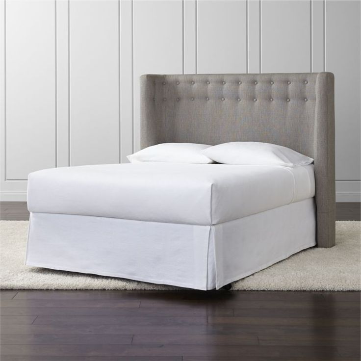 Shop Gia Upholstered Full Headboard.   A double row of hand-tufted button trim traces the headboard's curve, providing just the right amount of texture.  The Gia Upholstered Headboard are a Crate and Barrel exclusive.