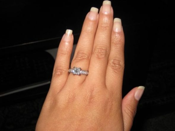 1 carat princess cut engagement ring on finger 53