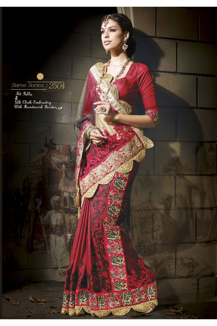 Red And Black Art Silk And Net Saree :- An art silk Saree in red is completed with a black net pallu. The Saree is decorated with silk cloth embroidery all over in black and red, embellished with stones. The hand embroidered border lace enhances the Saree in floral designs with Zari and thread, sequins and golden shimmer. The hemline is adorned with gota lace. The Saree is teamed with a designer blouse in red.
