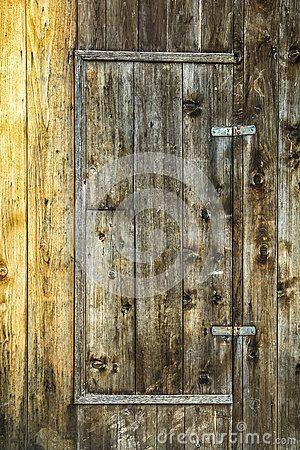 Old wooden door in wooden wall