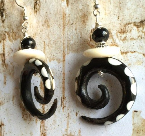 Solid Spiral Hook made out of Horn with bone inlays. Unique one of a kind earring loaded with interesting accented beads.The earring have black gemstone beads and ivory colored bone spacer beads.