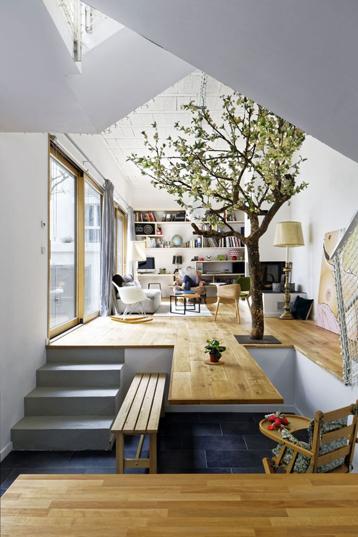 Interior Design Ideas - The floor of this living room extends and becomes a  cantilevered dining