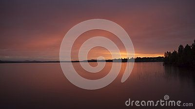 Scenic view of a picturesque sunset over a lake in Boden, Sweden.