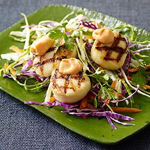 Grilled Sea Scallops with Spicy Ginger Aioli: A super-flavorful, Asian-spiced aioli punches up grilled scallops. Serve them on a bed of shredded veggies or skewer them for easy party food.