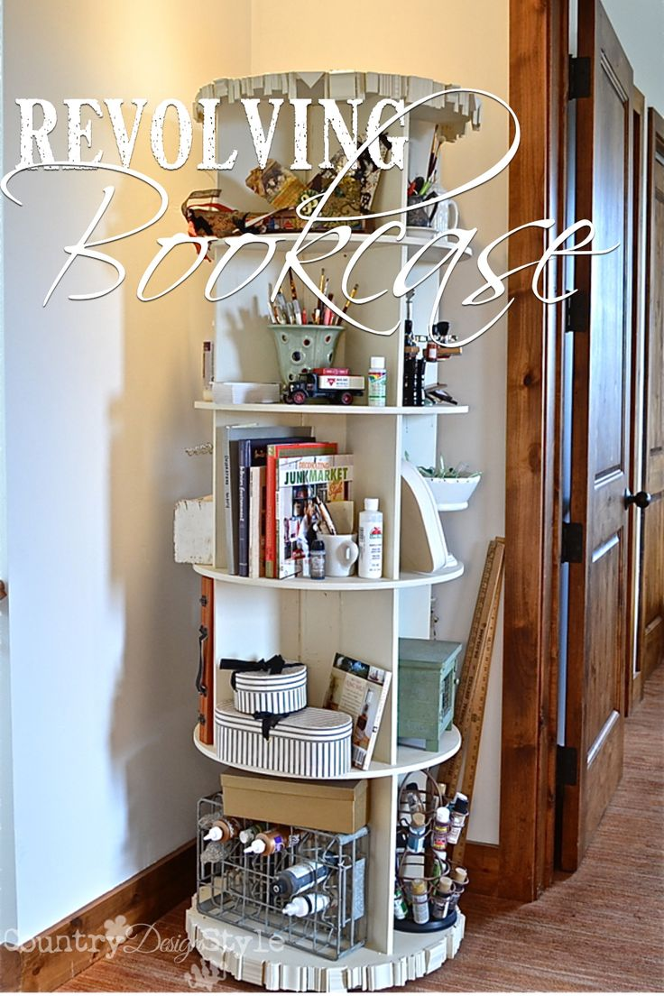 Total craft room organizational piece!  A revolving bookcase!  PLUS the ugly items can be hidden on the back side.  Country Design Style http://countrydesignstyle.com