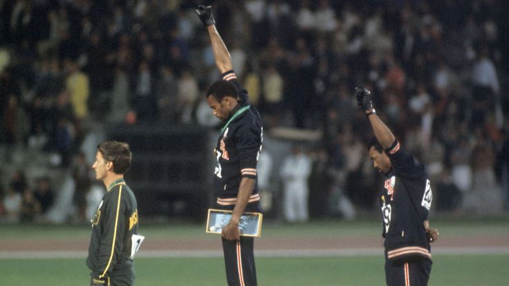 Peter Norman, Tommie Smith, and John Carlos, as they play the national anthem of the United States at the 1968 Olympics in Mexico City. (Credit: Rich Clarkson/Rich Clarkson & Associates/Getty Images)