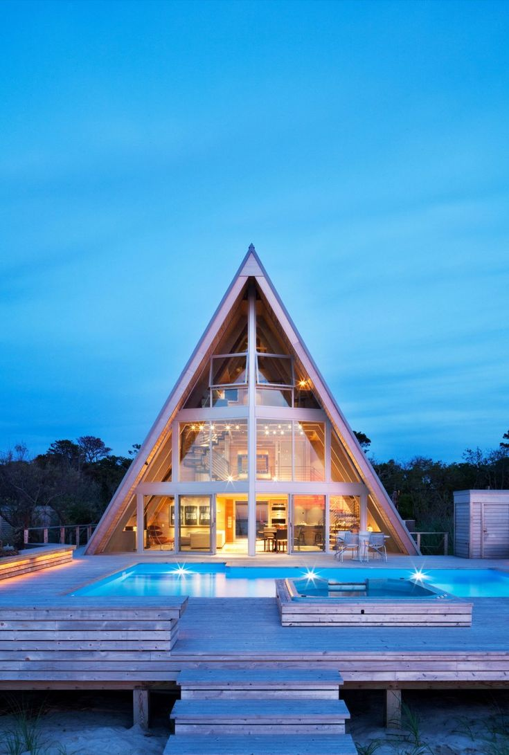 New York City-based studio Bromley Caldari Architects completed this 1960s A-frame beach home located on Fire Island in the state of New York, USA.