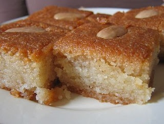 Basbousa Cake- Middle Eastern dessert. Almond Lemon cake with a honey syrup poured on top <3
