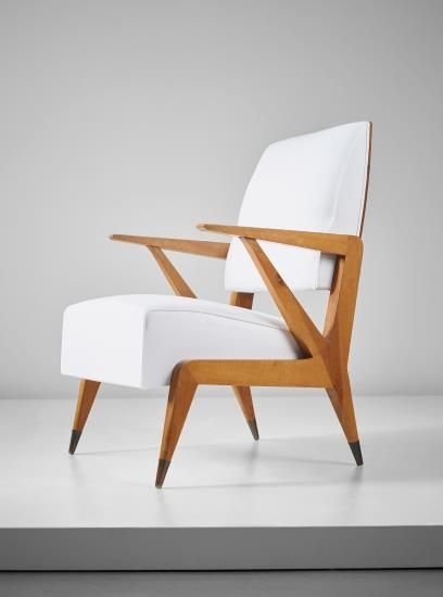 PHILLIPS : NY050315, Gio Ponti Rare armchair , circa 1948 Walnut, brass, fabric. 35 x 23 1/2 x 26 3/4 in. (89 x 59.7 x 68 cm) Together with a certificate of authenticity from the Gio Ponti Archives. Estimate $15,000 - 20,000