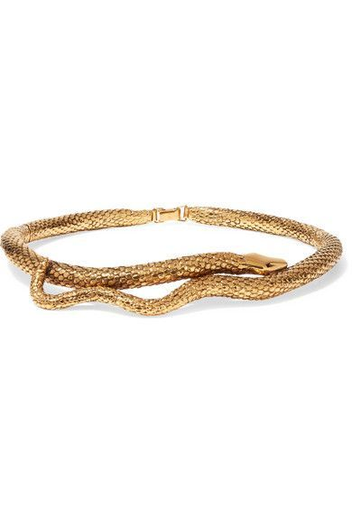 Aurélie Bidermann's 'Tao' choker is part of a collection of pieces designed to emulate the fluidity and movement of a snake. Expertly cast in France from gold-plated brass, it's embossed with lifelike scales and curves elegantly around your neck. Continue the sculptural feel with a one-shoulder top.