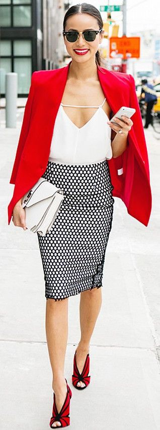 Jamie Chung wearing a red structured blazer, white cami, mesh-covered pencil skirt and red and black heels