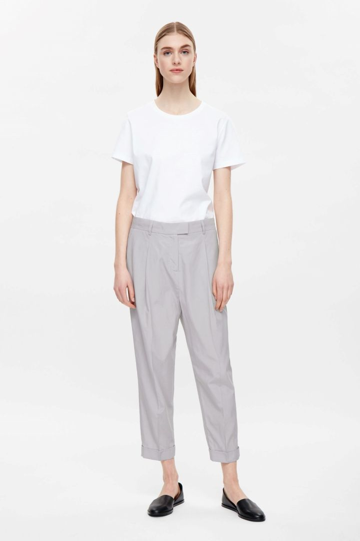 COS image 4 of Relaxed pleated trousers in Light Grey