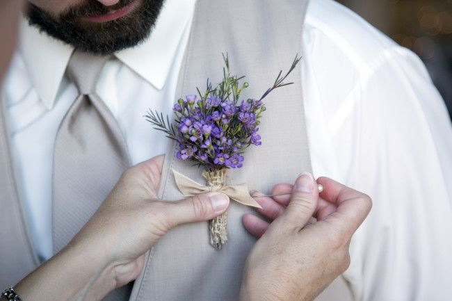 Small purple flower boutonniere created by Buttercups Floral Design