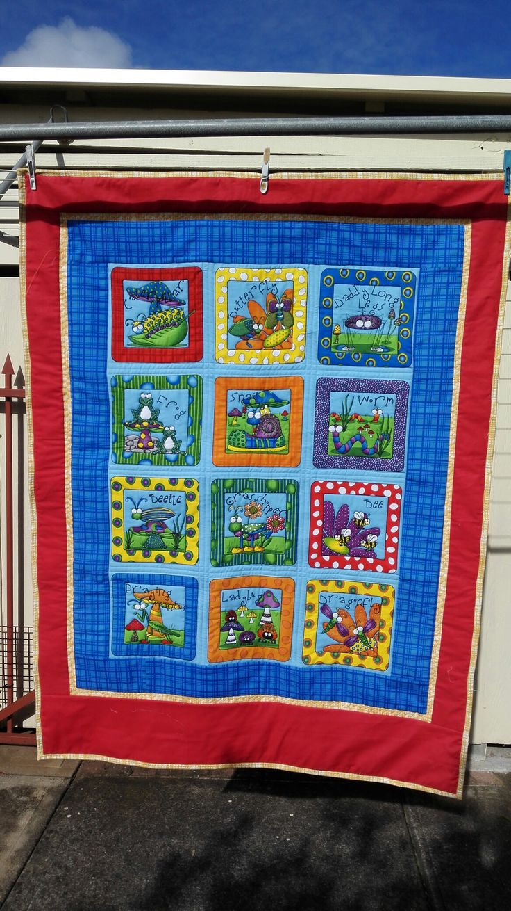 A baby boys quilt waiting for the name to be put on the bottom.
