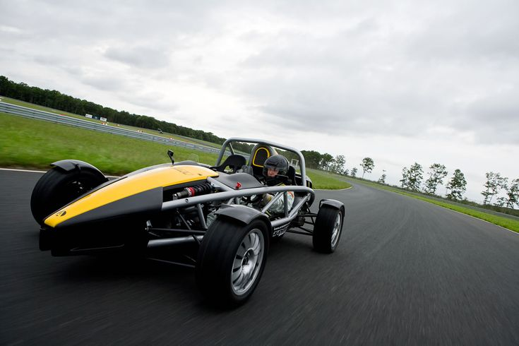 Ariel Atom 3 - the coolest car under 50k  Okay, so things like headlights, wind screens and license plate holders are extra.  But it is the coolest car ever!!!