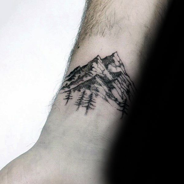 Small Simple Guys Forest Wrist Tattoo With Mountains