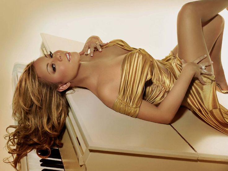 Mariah Carey - Definitely one of my top 5 singers of ALL TIME! Her voice is an instrument touched by God, she gorgeous and she's not afraid to show a little (or a lot) of skin! <3