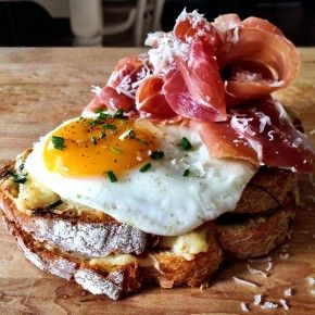 The French way to perfect the breakfast sandwich...prosciutto, eggs and gruyere on toasted baguette.