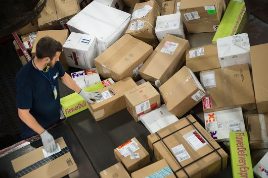 Sorting parcels & packages at a FedEx Express centre