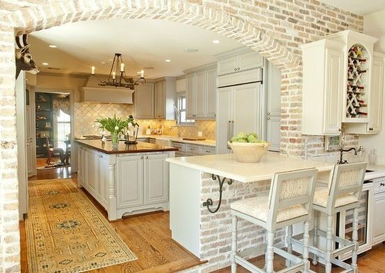 Arco de separaci n de cocina americana revestido en for White exposed brick wall