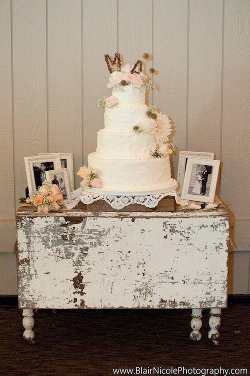 Cake table #vintage wedding photos. Backdrop palest pink.