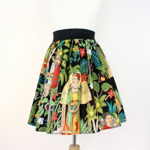 This is a fun pleated full skirt. Frida Kahlo comes alive in this amazing print. Frida is in a tropical forest setting surrounded by her monkey