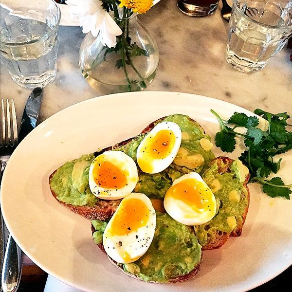 """28 Delicious NYC Toast Dishes To Try #refinery29  http://www.refinery29.com/best-toast-restaurants-new-york#slide-1  1. The East Pole Kitchen & Bar """"The East Pole's avocado toast comes with two perfectly sous vide soft-boiled eggs, house-made hot sauce, and a heaping crown of cilantro. They use a half-inch-thick slice of Pain D'Avignon's sourdough, and have a hardcore devotion to all-organic local purveyors. (An interactive map shows which farm is hatching that egg up on your plate!)""""The…"""