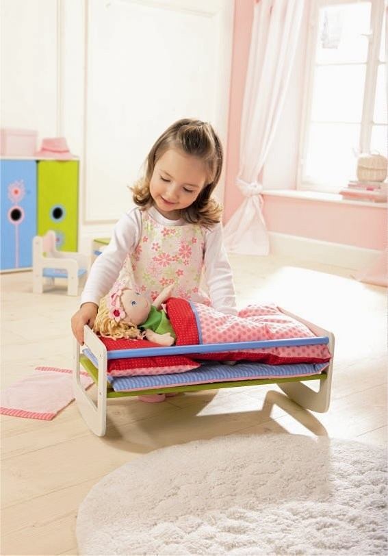 HABA's Doll Bed is reversible! Use as a rocking crib or a big kid's bed for your doll!