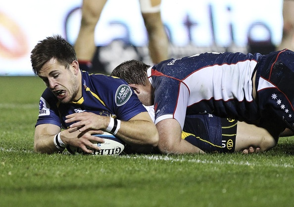 Zack Holmes of the Brumbies scores a try during the round 17 Super Rugby match between the Brumbies and the Rebels at Canberra Stadium on June 7, 2013 in Canberra, Australia.