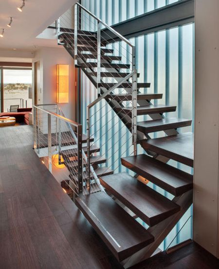 contemporary modern staircase with steel and wire sides ...