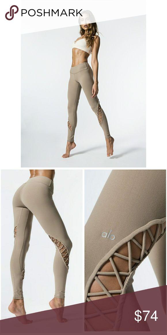 Alo Entwine yoga cut out legging in gravel L Alo Entwine yoga Legging  in gravel. Criss cross cut outs. Sz L  More pix to come! ALO Yoga Pants Leggings