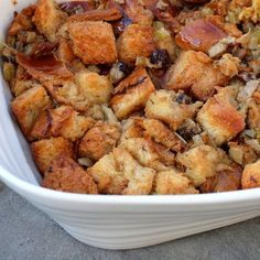 Challah wild mushroom & herb stuffing. I used veg broth in place of chicken, and ciabatta (Trader Joe's was out of challah). However, I have made with challah and it is divine!  I also subbed earth balance (stick form) for butter, and I cook it longer than 25 min...maybe more like an hour, so it's not soggy.