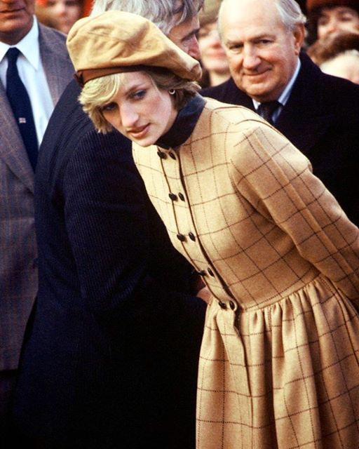 Instagram media by princess.diana.forever - 01 November 1982: Princess Diana visit Twyn in North Wales. She wears a suede beret by John Boyd and a camel colored coat dress by Arabella Pollen ■ #princessdianaforever #humanitarian #princessofwales #princessdiana #gb #hertruestory #kensingtonpalace #uk #thebritishroyalfamily #theroyalfamily #thebritishmonarchy #queenofhearts #instagood #instaroyal #instalike #di #fashionicon #peoplesprincess #style #glamorous #icon #foreveryoung #uk