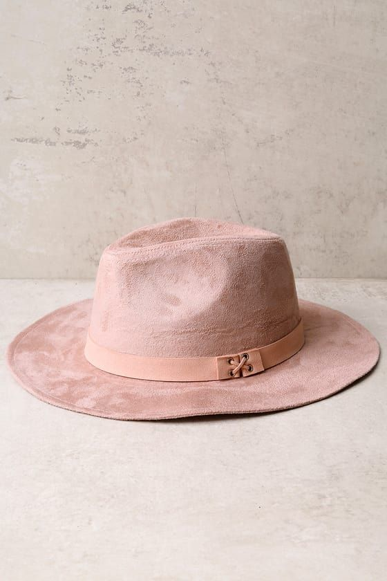 "All you need to complete your look is the Top It Off Blush Pink Suede Fedora Hat! Soft vegan suede covers this classic fedora hat with lace-up accents (and gold grommets) at the vegan suede band. 3"" brim."