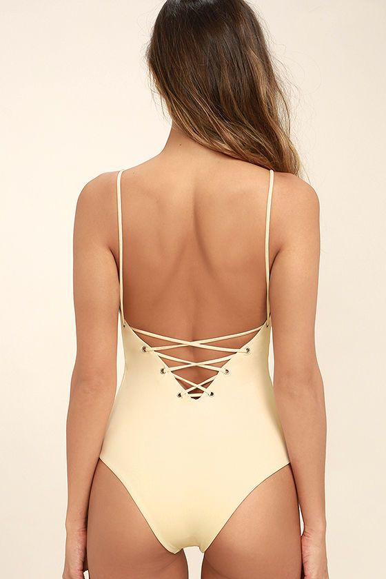 The Tavik Monahan Beige Lace-Up One Piece Swimsuit is so hot it's raising temperatures wherever it goes! Sleek and stretchy knit forms this sultry one-piece with a plunging, lace-up front and back (with silver grommets). Bottoms have a cheeky cut. PLEASE NOTE: Swimwear returned without the hygienic liner is non-refundable.