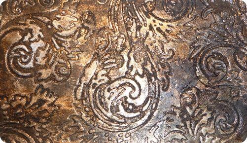 Aluminium Foil, Black Kaisercraft Paint, Tim Holtz Walnut Distress Ink, Walnut Embossing Powder, Adironack Ink – Hazelnut and Heirloom Gold Perfect Pearls Mists. Embossing Plates.