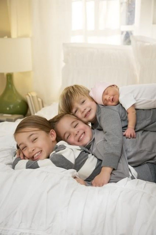 cute photo of sisters and brothers with newborn baby