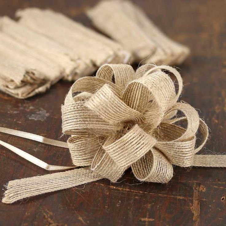 Rustic Christmas gift wrap - natural jute pull bow.