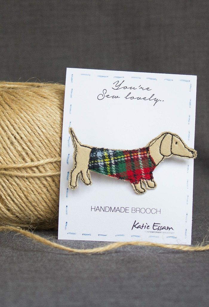 Handmade, freehand machine embroidered and appliquéd fabric brooches. Made with cotton, linen and thread. Presented on a card backing entitled 'You're sew lovely' with a 45mm brooch bar. Packaged in a cellophane bag.  Sausage Dog Brooch 7 cm by 3.5 cm