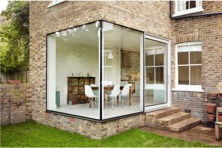 Cousins and Cousins removed the original bricks to use elsewhere and created these fabulous frameless windows.