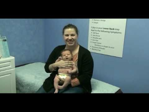 An Infant getting a Spinal Scan for Colic and Reflux at Van Every Family Chiropractic Center in Royal Oak, MI