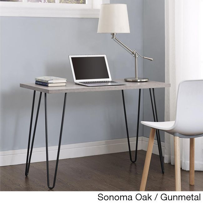 Simplicity and functionality come together in the Altra Owen Retro Desk. The slender silhouette allows the Owen Desk to easily fit in small spaces
