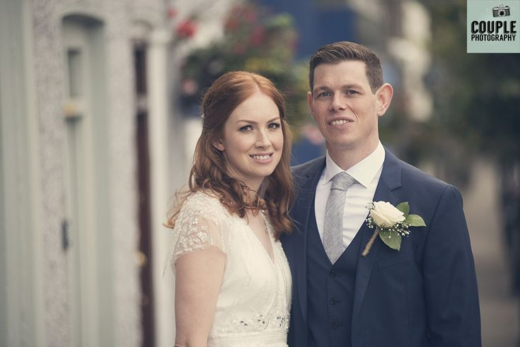 The newlyweds step outside onto the picturesque main street in Slane. Weddings at Conyngham Arms Hotel, Slane, by Couple Photography.